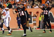 Nov 5, 2015; Cincinnati, OH, USA; Cincinnati Bengals quarterback Andy Dalton (14) reacts to throwing a touchdown pass to tight end Tyler Eifert (not pictured) in the first half against the Cleveland Browns at Paul Brown Stadium. Mandatory Credit: Aaron Doster-USA TODAY Sports