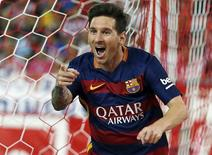 Barcelona's Lionel Messi celebrates after scoring a goal against Atletico Madrid during their Spanish first division soccer match at Vicente Calderon stadium in Madrid, September 12, 2015. REUTERS/Javier Barbancho