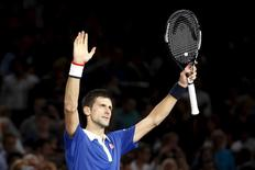 World number one Novak Djokovic of Serbia reacts after defeating Stan Wawrinka of Switzerland in their men's singles semi-final tennis match at the Paris Masters tennis tournament at the Bercy sports hall in Paris, France, November 7, 2015. REUTERS/Charles Platiau