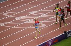 Russia's Mariya Savinova smiles as she wins gold in the women's 800m final at the London 2012 Olympic Games at the Olympic Stadium in this August 11, 2012 file photo. REUTERS/Max Rossi/Files