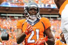 Sep 13, 2015; Denver, CO, USA; Denver Broncos cornerback Aqib Talib (21) celebrates after scoring a touchdown after intercepting a pass during the second half against the Baltimore Ravens at Sports Authority Field at Mile High. Mandatory Credit: Chris Humphreys-USA TODAY Sports