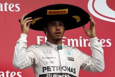 Mercedes Formula One driver Lewis Hamilton of Britain reacts after he took second place in the Mexican F1 Grand Prix at Autodromo Hermanos Rodriguez in Mexico City, November 1, 2015.      REUTERS/Henry Romero