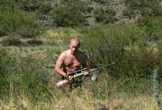 Президент России Владимир Путин в Туве 15 августа 2007 года. Россия не будет втягиваться в гонку вооружений с Западом, сказал в среду президент Владимир Путин, накануне пообещавший ответить на американскую противоракетную оборону разработкой оружия, способного ее преодолеть. REUTERS/RIA Novosti/KREMLIN