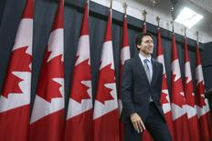 Canada's Prime Minister Justin Trudeau leaves at the conclusion of a news conference in Ottawa, Canada November 12, 2015. REUTERS/Chris Wattie