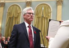 Canada's new Natural Resources Minister Jim Carr is sworn-in during a ceremony at Rideau Hall in Ottawa November 4, 2015. REUTERS/Chris Wattie