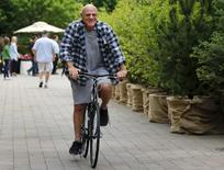 Barry Diller, Chairman and Senior Executive of IAC/InterActiveCorp and Expedia, Inc., rides a bike during the first day of the annual Allen and Co. media conference in Sun Valley, Idaho July 8, 2015. REUTERS/Mike Blake