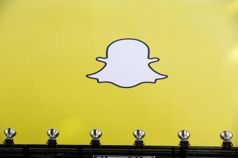 A billboard displays the logo of Snapchat above Times Square in New York March 12, 2015. REUTERS/Lucas Jackson