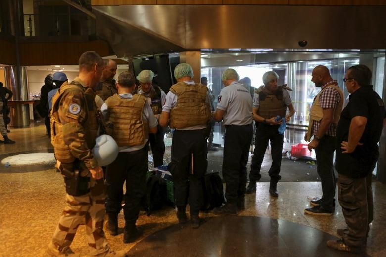 French gendarmes prepare forensic supplies in the lobby of the Radisson hotel in Bamako, Mali, November 20, 2015. REUTERS/Joe Penney