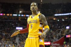 Nov 19, 2015; Cleveland, OH, USA; Cleveland Cavaliers guard J.R. Smith (5) reacts after making a three-point basket in the second quarter against the Milwaukee Bucks at Quicken Loans Arena. Mandatory Credit: David Richard-USA TODAY Sports