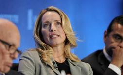 "Laurene Powell Jobs, founder and chair of Emerson Collective and widow of the late Apple founder Steve Jobs, along with Los Angeles Mayor Antonio Villaraigosa (R) and Rupert Murdoch (L), chairman and CEO of News Corporation, takes part in a panel discussion titled ""Immigration Strategy for the Borderless Economy"" at the Milken Institute Global Conference in Beverly Hills, California April 29, 2013. REUTERS/Gus Ruelas"