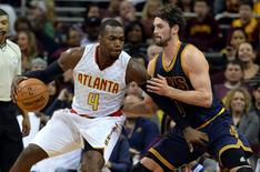 Nov 21, 2015; Cleveland, OH, USA; Atlanta Hawks forward Paul Millsap (4) drives against Cleveland Cavaliers forward Kevin Love (0) during the first quarter at Quicken Loans Arena. Mandatory Credit: Ken Blaze-USA TODAY Sports
