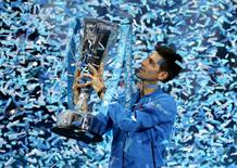 Serbia's Novak Djokovic celebrates with the trophy after winning the Barclays ATP World Tour Finals against Switzerland's Roger FedererAction Images via Reuters / Alex Morton