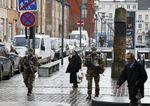Belgian soldiers patrol in the neighborhood of Molenbeek, in Brussels, Belgium, November 22, 2015, after security was tightened in Belgium following the fatal attacks in Paris.   REUTERS/Youssef Boudlal