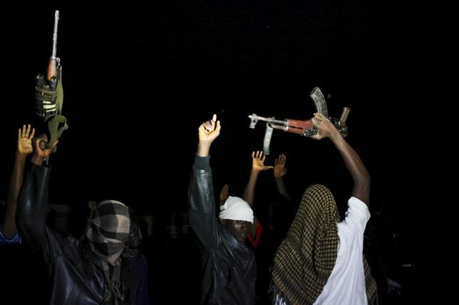 Armed vigilantes holds AK-47 before they patrol in the center of Bujumbura, Burundi, November 20, 2015. REUTERS/Goran Tomasevic