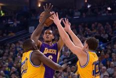 Los Angeles Lakers guard Jordan Clarkson (6) shoots the basketball against Golden State Warriors forward Draymond Green (23) and guard Klay Thompson (11) during the first quarter at Oracle Arena. Mandatory Credit: Kyle Terada-USA TODAY Sports