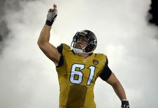 Nov 19, 2015; Jacksonville, FL, USA; Jacksonville Jaguars center Stefen Wisniewski (61) runs through smoke onto the field during player introductions before an NFL football game against the Tennessee Titans at EverBank Field. Mandatory Credit: Kirby Lee-USA TODAY Sports
