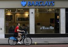 A man rides a bicycle past a Barclays bank in London August 5, 2010.  REUTERS/Suzanne Plunkett