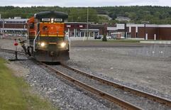 An engine runs on the railway in downtown Lac Megantic, June 21, 2014.  REUTERS/Mathieu Belanger