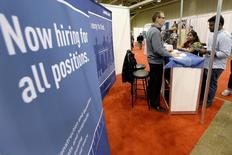 Exhibitors speak with visitors at the 2014 Spring National Job Fair and Training Expo in Toronto, April 3, 2014. REUTERS/Aaron Harris