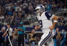 Nov 26, 2015; Arlington, TX, USA; Dallas Cowboys quarterback Tony Romo (9) comes off the field after throwing his second interception for a touchdown during the second quarter of an NFL game against the Carolina Panthers on Thanksgiving at AT&T Stadium. Mandatory Credit: Jerome Miron-USA TODAY Sports