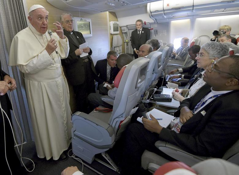 Pope Francis gestures during a meeting with the media onboard the papal plane while en route to Rome, Italy, November 30, 2015.  REUTERS/Daniel Dal Zennaro/pool