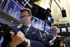 Traders work on the floor of the New York Stock Exchange November 24, 2015. REUTERS/Brendan McDermid