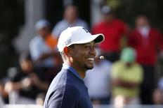 U.S. golfer Tiger Woods smiles during a golf clinic in Mexico City October 20, 2015. REUTERS/Edgard Garrido