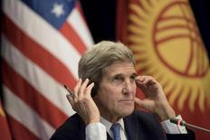 U.S. Secretary of State John Kerry listens to a translation during a news conference at the Ala Archa compound in Bishkek, October 31, 2015. REUTERS/Brendan Smialowski/Pool - RTX1U3FE