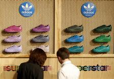 Shareholders of Adidas look at shoes during the company's annual general meeting in the northern Bavarian town of Fuerth near Nuremberg, Germany, in this May 7, 2015 file photo.    REUTERS/Michaela Rehle/Files