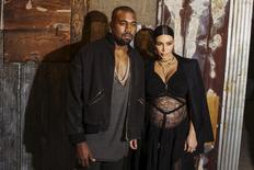 Musician Kanye West stands with his wife Kim Kardashian after watching the Givenchy Spring/Summer 2016 collection during New York Fashion Week in New York, in this file photo taken September 11, 2015.    REUTERS/Lucas Jackson/Files