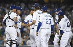 October 9, 2015; Los Angeles, CA, USA; Los Angeles Dodgers starting pitcher Clayton Kershaw (22) is relieved in the seventh inning by manager Don Mattingly (8) in the seventh inning against the New York Mets in game one of the NLDS at Dodger Stadium. Mandatory Credit: Richard Mackson-USA TODAY Sports