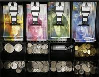 Swiss franc coins are seen in a cash drawer in this picture illustration in Bern January 16, 2015. REUTERS/Thomas Hodel