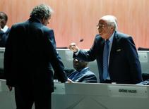 FIFA President Sepp Blatter (R) speaks with UEFA President Michel Platini at the 65th FIFA Congress in Zurich, Switzerland, in this May 29, 2015 file photo. REUTERS/Ruben Sprich