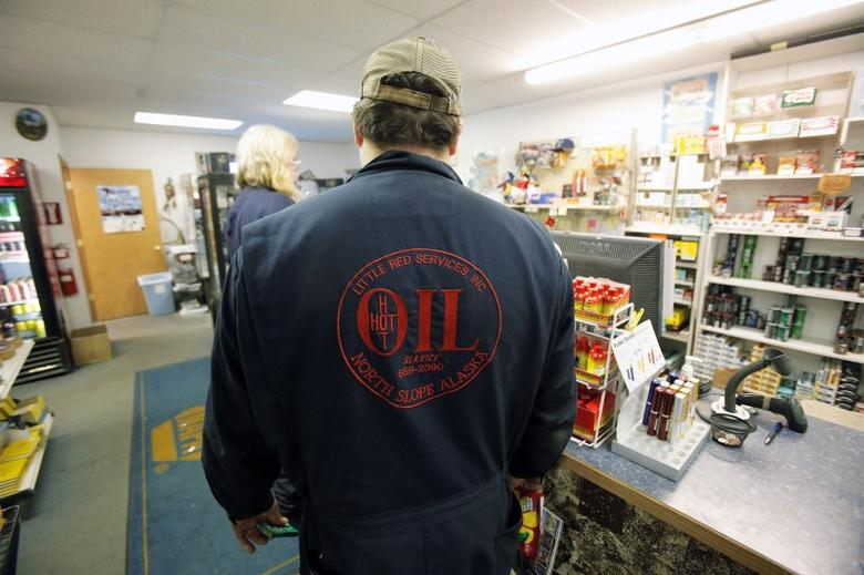 A worker waits in line at the general store in Prudhoe Bay, Alaska March 17, 2011.  REUTERS/Lucas Jackson