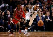 Boston Celtics guard Isaiah Thomas (4) returns the ball against Chicago Bulls guard Jimmy Butler (21) in the second half at TD Garden. David Butler II-USA TODAY Sports