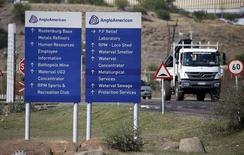A truck drives past an AngloAmerican sign board at the company refinery, outside Rustenburg, northwest of Johannesburg October 5, 2015. REUTERS/Siphiwe Sibeko