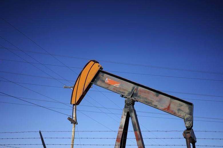 An oil well pump jack is seen at an oil field supply yard near Denver, Colorado February 2, 2015. REUTERS/Rick Wilking