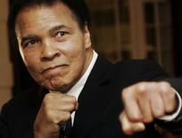 U.S. boxing great Muhammad Ali poses during the Crystal Award ceremony at the World Economic Forum (WEF) in Davos, Switzerland January 28, 2006. REUTERS/Andreas Meier/Files