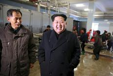North Korean leader Kim Jong Un gives field guidance to the August 25 Fishery Station under KPA Unit 313, in this undated photo released by North Korea's Central News Agency (KCNA) on November 23, 2015. REUTERS/KCNAATTENTION EDITORS - THIS PICTURE WAS PROVIDED BY A THIRD PARTY. REUTERS IS UNABLE TO INDEPENDENTLY VERIFY THE AUTHENTICITY, CONTENT, LOCATION OR DATE OF THIS IMAGE. FOR EDITORIAL USE ONLY. NOT FOR SALE FOR MARKETING OR ADVERTISING CAMPAIGNS. NO THIRD PARTY SALES. SOUTH KOREA OUT. NO COMMERCIAL OR EDITORIAL SALES IN SOUTH KOREA. THIS PICTURE IS DISTRIBUTED EXACTLY AS RECEIVED BY REUTERS, AS A SERVICE TO CLIENTS.