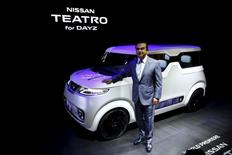 Carlos Ghosn, chief executive officer of Nissan Motor Co and Renault SA, poses in front of the Nissan Teatro for Dayz concept car at the 44th Tokyo Motor Show in Tokyo October 28, 2015.  REUTERS/Thomas Peter