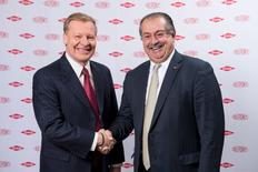 Edward D. Breen (L), chairman and chief executive officer of DuPont, is pictured shaking hands with Andrew N. Liveris, Dow's chairman and chief executive officer, in this undated handout photo provided by DuPont.  REUTERS/DuPont/Handout via Reuters