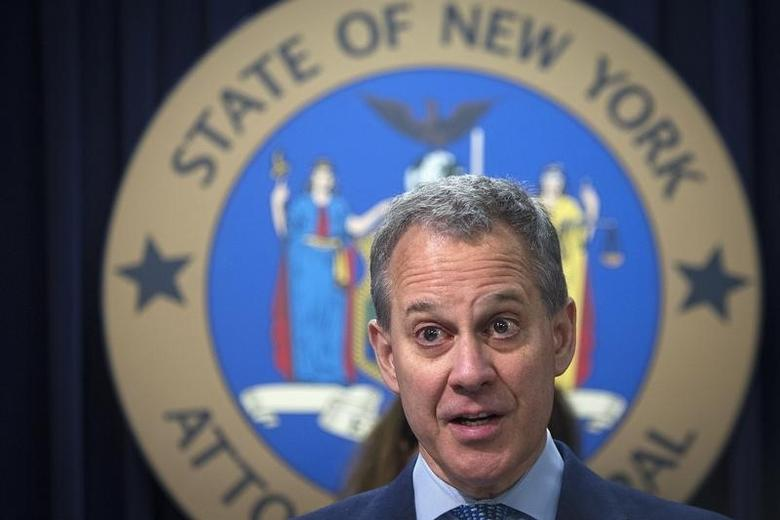 New York State Attorney General Eric Schneiderman speaks during a news conference in the Manhattan borough of New York August 21, 2014. REUTERS/Carlo Allegri