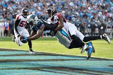 Carolina Panthers tight end Ed Dickson (84) catches a touchdown as Atlanta Falcons cornerback Robert Alford (23) defends in the second quarter at Bank of America Stadium. Bob Donnan-USA TODAY Sports
