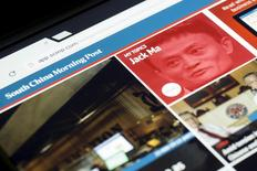 The South China Morning Post website and an image of Jack Ma, founder and executive chairman of Alibaba Group Holding Ltd, are displayed on a computer in Hong Kong, China, in this November 23, 2015 file photo illustration. REUTERS/Tyrone Siu/Files