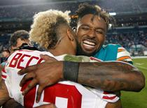 Dec 14, 2015; Miami Gardens, FL, USA; New York Giants wide receiver Odell Beckham Jr (13) hugs Miami Dolphins wide receiver Jarvis Landry (14) after the Giants defeated the dolphins 31-24 at Sun Life Stadium. Mandatory Credit: Andrew Innerarity-USA TODAY Sports
