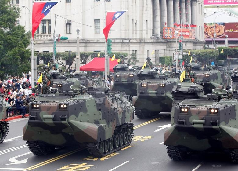 AAV-P7A1 amphibious assault vehicles of the Taiwan Marine Corps are seen as part of a parade during Taiwan's National Day celebrations in front of the Presidential Office in Taipei October 10, 2011. REUTERS/Pichi Chuang