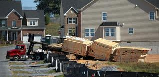 Wood for framing new homes is unloaded at a large subdivision in Damascus, Maryland in this file photo from September 15, 2015.  REUTERS/Gary Cameron/Files