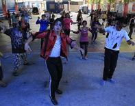 "Participants in zombie make-up dance to late U.S. singer Michael Jackson's ""Thriller"", during a ""Zombie Zumba Dance"" event in Malabon city, north of Manila October 26, 2014.  REUTERS/Romeo Ranoco"