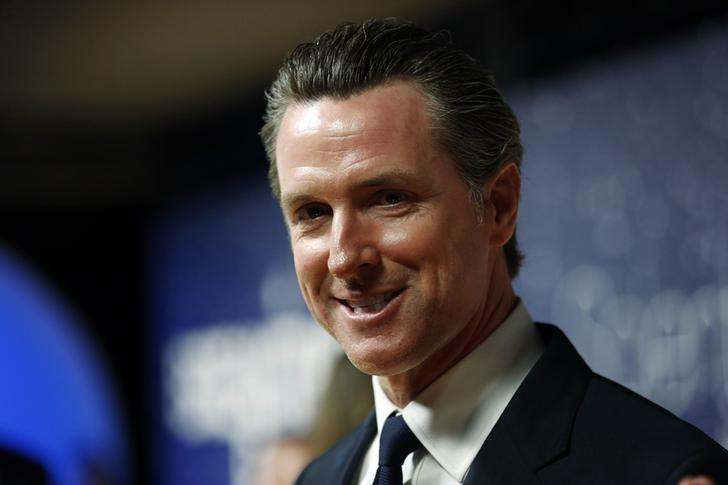 California Lt. Governor Gavin Newsom arrives on the red carpet during the 2nd annual Breakthrough Prize Award in Mountain View, California November 9, 2014. REUTERS/Stephen Lam