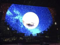 A massive screen located to the right of the main stage displays a digital interpretation of the day for night theme of the Day for Night Festival in Houston, Texas, December 18, 2015.   REUTERS/Amanda Orr